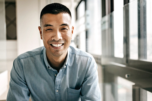 Asian Man Smiling GettyImages 1168469141