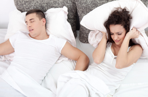 Couple suffering from snoring caused by Sleep Apnea, Middle Creek Dental, Shaun Christensen, DMD