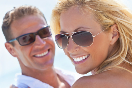 Man and woman in sunglasses smiling with whitened teeth by Middle Creek Dental, Nampa ID